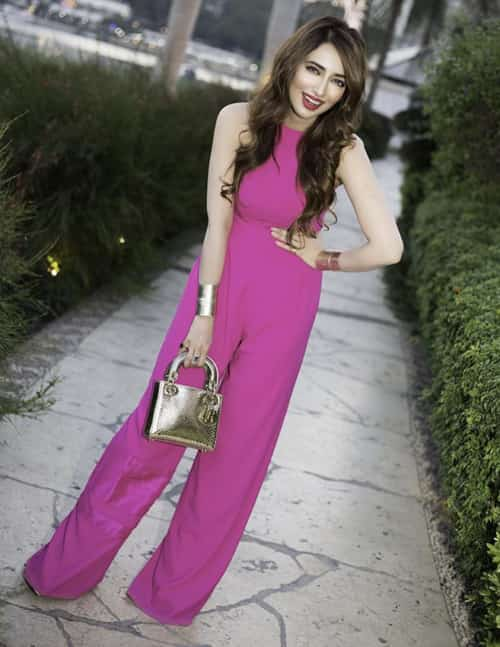 Wedding guest in a pink jumpsuit in Cairo